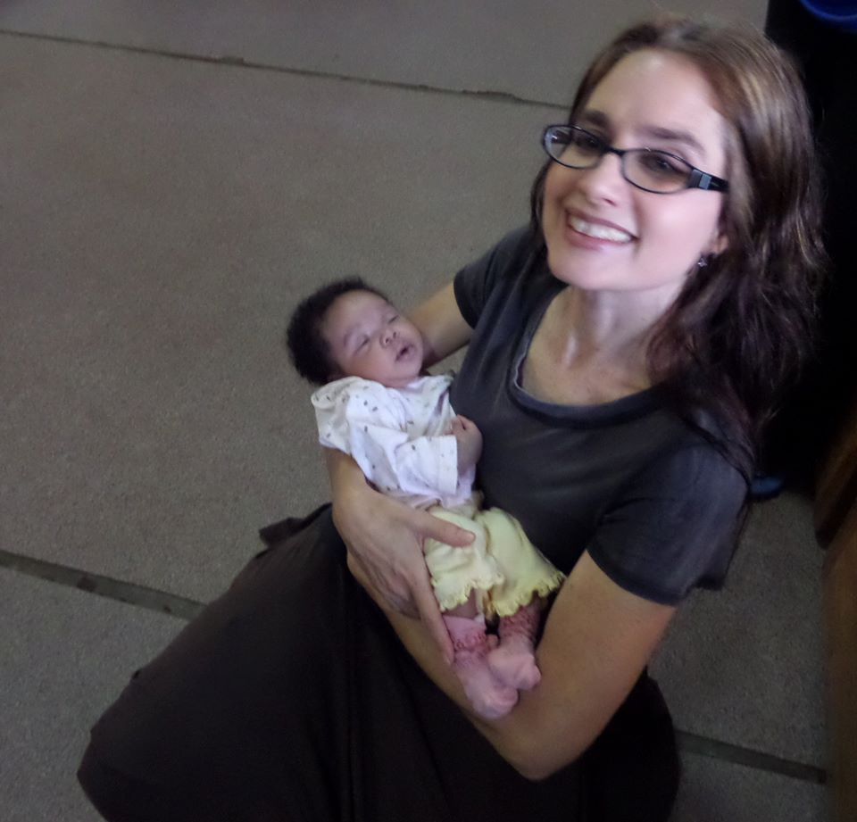 Mama Christina holding new baby at TOA